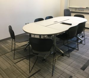 two rectangular tables and two half circle table grouped together