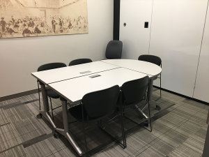 two rectangular tables and half circle table grouped together