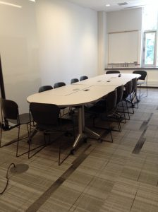 Long table seating 12 set up in meeting room