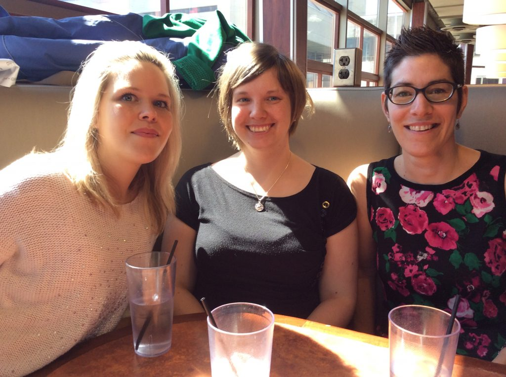Three library assistants at lunch in restaurant